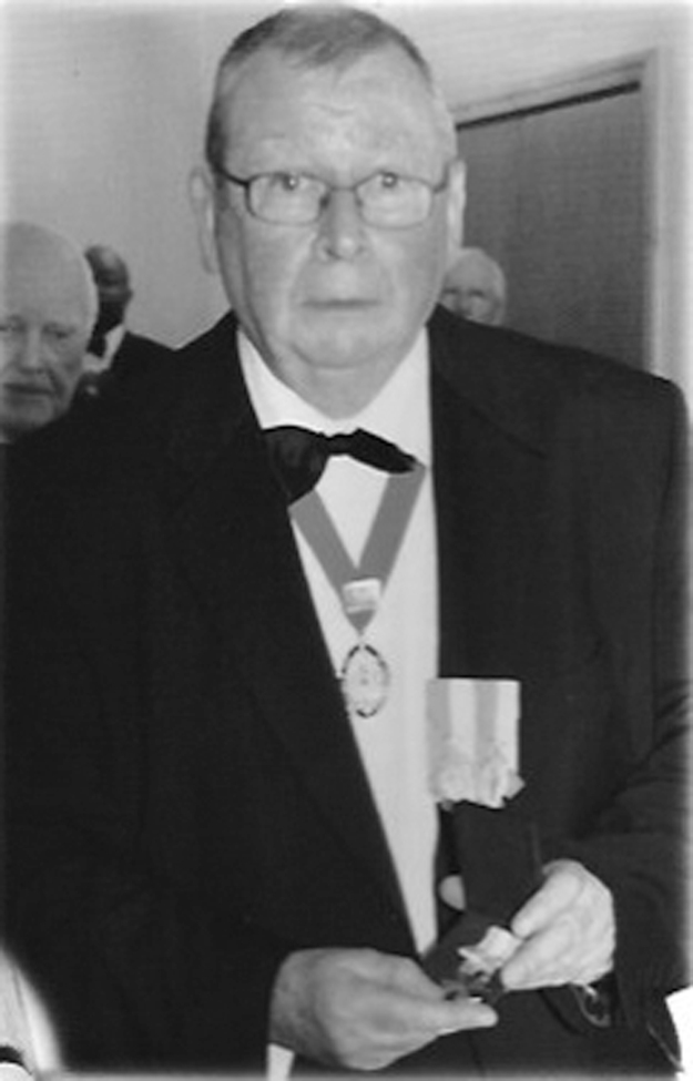 William Gallagher proudly holds the new medal, the Columba Cross