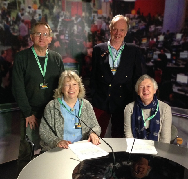 brothers and their wives pictured in the News studio