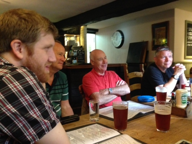 a group sitting down in a pub